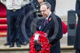 Remembrance Sunday at the Cenotaph in London 2014: The leader of the Democratic Unionist Party, Nigel Dodds, walking towards the Cenotaph with his wreath. Press stand opposite the Foreign Office building, Whitehall, London SW1, London, Greater London, United Kingdom, on 09 November 2014 at 11:08, image #230
