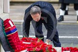 Remembrance Sunday at the Cenotaph in London 2014: The leader of the Democratic Unionist Party, Nigel Dodds, laying his wreath at the Cenotaph. Press stand opposite the Foreign Office building, Whitehall, London SW1, London, Greater London, United Kingdom, on 09 November 2014 at 11:08, image #232