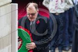 Remembrance Sunday at the Cenotaph in London 2014: Elfyn Llwyd, as leader of the Plaid Cymru / SNP Parliamentary Group, laying his wreath at the Cenotaph. Press stand opposite the Foreign Office building, Whitehall, London SW1, London, Greater London, United Kingdom, on 09 November 2014 at 11:08, image #234