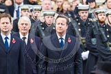 Remembrance Sunday at the Cenotaph in London 2014: The Prime Minister, David Cameron. Next to him Nick Clegg, leader of the Liberal Democrats, behind them former prime minister John Major. Press stand opposite the Foreign Office building, Whitehall, London SW1, London, Greater London, United Kingdom, on 09 November 2014 at 11:15, image #264