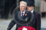 Remembrance Sunday at the Cenotaph in London 2014: Vice Admiral Peter Wilkinson, President of the Royal British Legion, walking towards the Cenotaph with his wreath. Press stand opposite the Foreign Office building, Whitehall, London SW1, London, Greater London, United Kingdom, on 09 November 2014 at 11:26, image #302