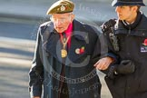 Remembrance Sunday at the Cenotaph in London 2014: An elderly gentleman lays a wreath, with thousands of spectators clapping. Press stand opposite the Foreign Office building, Whitehall, London SW1, London, Greater London, United Kingdom, on 09 November 2014 at 12:43, image #328