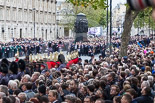 Remembrance Sunday at the Cenotaph 2015: The eastern side of Whitehall, with the three columns of veterans, waiting for the March Past, between the large numbers of specators lining both sides of the road. Image #69, 08 November 2015 10:45 Whitehall, London, UK