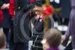 Remembrance Sunday at the Cenotaph 2015: HM The Queem at the Cenotaph, her face partially covered by the cross. Image #138, 08 November 2015 10:59 Whitehall, London, UK