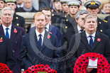 Remembrance Sunday at the Cenotaph 2015: The Leader of the Liberal Democrats, Tim Fallon, and the Westminster Leader of the Scottish National Party, Angus Robertson. Behind them the Secretary of State for Defence, Michael Fallon, the Chancellor of the Exchequer, George Osborne, and former prime ministers Gordon Brown. Image #155, 08 November 2015 11:02 Whitehall, London, UK