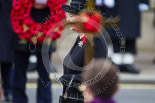 Remembrance Sunday at the Cenotaph 2015: HM The Queen, her face partially hidden by the cross. Image #159, 08 November 2015 11:02 Whitehall, London, UK