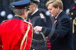 Remembrance Sunday at the Cenotaph 2015: HM The King of the Netherlands reveiving his wreath from his equerry, Major-General Hans van der Louw. Image #180, 08 November 2015 11:04 Whitehall, London, UK