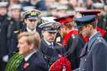 Remembrance Sunday at the Cenotaph 2015: The Equerry to HRH The Duke of Cambridge,  Lieutenant  Commander  James  Benbow, Royal Navy, handing over the wreath to Prince William. Behind them, Captain  Edward  Lane  Fox, Equerry to HRH Prince Henry of Wales, is handing over the wreath to Prince Harry. Image #189, 08 November 2015 11:05 Whitehall, London, UK