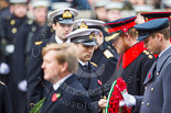 Remembrance Sunday at the Cenotaph 2015: The Equerry to HRH The Duke of Cambridge,  Lieutenant  Commander  James  Benbow, Royal Navy, handing over the wreath to Prince William. Behind them, Captain  Edward  Lane  Fox, Equerry to HRH Prince Henry of Wales, is handing over the wreath to Prince Harry. Image #190, 08 November 2015 11:05 Whitehall, London, UK