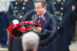 Remembrance Sunday at the Cenotaph 2015: The Prime Minister, David Cameron, about to lay his wreath at the Cenotaph. Image #204, 08 November 2015 11:06 Whitehall, London, UK