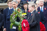 Remembrance Sunday at the Cenotaph 2015: The Westminster Leader of the Scottish National Party, Angus Robertson, walking towards the Cenotaph with his wreath. Image #215, 08 November 2015 11:07 Whitehall, London, UK