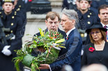 Remembrance Sunday at the Cenotaph 2015: The Secretary of State for Foreign and Commonwealth Affairs, Philip Hammond, walking toward the Cenotaph with his wreath on behalf of 14 overseas terretories. The wreath is made of flowers from all 14 terretories. Image #222, 08 November 2015 11:08 Whitehall, London, UK
