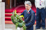 Remembrance Sunday at the Cenotaph 2015: The Secretary of State for Foreign and Commonwealth Affairs, Philip Hammond, about to lay his wreath at the Cenotaph. Image #223, 08 November 2015 11:08 Whitehall, London, UK