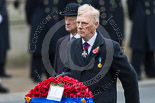 """Remembrance Sunday at the Cenotaph 2015: Vice Admiral Peter Wilkinson, President of the Royal British Legion, approaches the Cenotaph with his wreath. """"In Remembrance of our fallen comrades from the board of trustees and all members of the Royal British Legion"""". Image #330, 08 November 2015 11:24 Whitehall, London, UK"""