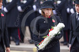 Remembrance Sunday at the Cenotaph 2015: A group I can't identify laying a wreath at the Cenotaph after the Ceremony and before the March Past. Image #353, 08 November 2015 11:30 Whitehall, London, UK