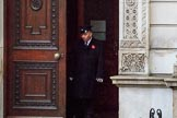The doors of the Foreign and Commonwealth Office are opened on a wet morning before the Remembrance Sunday Cenotaph Ceremony 2018 at Horse Guards Parade, Westminster, London, 11 November 2018, 08:04.