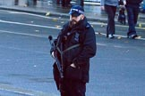Armed police on Whitehall before the Remembrance Sunday Cenotaph Ceremony 2018 at Horse Guards Parade, Westminster, London, 11 November 2018, 08:31.