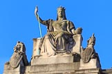 The statue of Queen Victoria as Britannia, seated between a lion and a unicorn, on top of the Foreign and Commonwealth Office overlooking the proceedings before the Remembrance Sunday Cenotaph Ceremony 2018 at Horse Guards Parade, Westminster, London, 11 November 2018, 08:46.