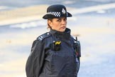 A female Metropolitan Police Constable keeping an eye on the crowds during Remembrance Sunday Cenotaph Ceremony 2018 at Horse Guards Parade, Westminster, London, 11 November 2018, 08:51.