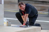 An Foreign and Commonwealth Office workman marking the position where the wreaths are to be laid around the Cenotaph before the Remembrance Sunday Cenotaph Ceremony 2018 at Horse Guards Parade, Westminster, London, 11 November 2018, 08:52.