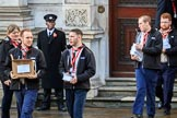 The The Queen's Scouts leaving the Foreign and Commonwealth Office to distribute the Order of Service in Whitehall before Remembrance Sunday Cenotaph Ceremony 2018 at Horse Guards Parade, Westminster, London, 11 November 2018, 09:13.