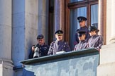 Army officers and an army photographer in one of the top floor windows of the Foreign and Commonwealth Office before the Remembrance Sunday Cenotaph Ceremony 2018 at Horse Guards Parade, Westminster, London, 11 November 2018, 09:52. I believe they control all or parts of the event - if you know more, please let me know!