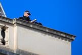 A police officer on the roof of the Foreign and Commonwealth Office before the Remembrance Sunday Cenotaph Ceremony 2018 at Horse Guards Parade, Westminster, London, 11 November 2018, 09:58.
