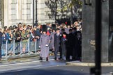 The first group of the March Past, I believe RBL officials, is waiting next to the Memorial for Women in World War II before the Remembrance Sunday Cenotaph Ceremony 2018 at Horse Guards Parade, Westminster, London, 11 November 2018, 10:07.