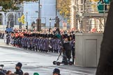 More army service detachments arriving on Whitehall before the Remembrance Sunday Cenotaph Ceremony 2018 at Horse Guards Parade, Westminster, London, 11 November 2018, 10:24. They all march from  Wellington Barracks via Birdcage Walk, Great George Street and Parliament Street to the Cenotaph