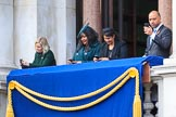 Early guests on one of the balconies of the Foreign and Commonwealth Office fiddling with their mobile phones before the Remembrance Sunday Cenotaph Ceremony 2018 at Horse Guards Parade, Westminster, London, 11 November 2018, 10:32.
