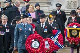 Air Marshal Sir Baz North, President of the Royal Air Forces Association  and representatives of The Royal British Legion, London Transport, the Royal Naval Association , the Royal Commonwealth Ex­Services League, the Royal British Legion Scotland, and the Royal British Legion Women's Section leaving the Foreign and Commonwealth Office before the Remembrance Sunday Cenotaph Ceremony 2018 at Horse Guards Parade, Westminster, London, 11 November 2018, 10:35.