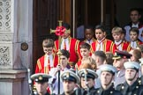 The Bishop's Procession, here the the Choir, led by the CrossBearer, Michael Clayton Jolly, leaving the Foreign and Commonwealth Office during the Remembrance Sunday Cenotaph Ceremony 2018 at Horse Guards Parade, Westminster, London, 11 November 2018, 10:53.