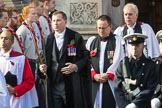 The Bishop's Procession leaving the Foreign and Commonwealth Office, here the Director of Music, Joseph McHardy, the Serjeant of the Vestry, Mr Jonathan Simpsonm and the ForcesChaplain, theVenerableJohnEllisQHCRAF,ChaplaininChieftothe RAF during the Remembrance Sunday Cenotaph Ceremony 2018 at Horse Guards Parade, Westminster, London, 11 November 2018, 10:53.