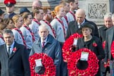 The Rt Hon Jeremy Corbyn MP, (Leader of the Labour Party and Leader of the Opposition)   and the Rt Hon Theresa May MP, Prime Minister, on behalf of the Government, leaving the Foreign and Commonwealth Office with their wreath during Remembrance Sunday Cenotaph Ceremony 2018 at Horse Guards Parade, Westminster, London, 11 November 2018, 10:55.