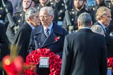 The Rt Hon The Lord Fowler, Lord Speaker, (on behalf of Parliament representing membersoftheHouseofLords)  carrying his wreath during the Remembrance Sunday Cenotaph Ceremony 2018 at Horse Guards Parade, Westminster, London, 11 November 2018, 10:55. Behind him former prime ministers Gordon Brown and Tony Blair.
