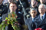The Rt Hon Jeremy Hunt MP, Secretary of State for Foreign and Commonwealth Affairs, on behalf of the United Kingdom Overseas Territories and The Rt Hon The Lord Fowler, Lord Speaker, (on behalf of Parliament representing members of the House of Lords)   with their wreaths during the Remembrance Sunday Cenotaph Ceremony 2018 at Horse Guards Parade, Westminster, London, 11 November 2018, 10:57.