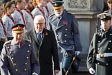 HE The President of the Federal Republic of Germany, Frank-Walter Steinmeier, in focus, between HRH The Prince of Wales (Prince Charles) and HRH The Duke of Kent (Prince Edward) during the Remembrance Sunday Cenotaph Ceremony 2018 at Horse Guards Parade, Westminster, London, 11 November 2018, 10:58.