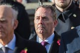 The Rt Hon Dr Liam Fox MP (Secretary of State for International Trade) during the Remembrance Sunday Cenotaph Ceremony 2018 at Horse Guards Parade, Westminster, London, 11 November 2018, 11:03.
