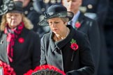 The Rt Hon Theresa May MP, Prime Minister, with her wreath on behalf of the Government during the Remembrance Sunday Cenotaph Ceremony 2018 at Horse Guards Parade, Westminster, London, 11 November 2018, 11:07.