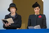 Mrs. Elke Büdenbender, wife of HE The President of the Federal Republic of Germany, Frank-Walter Steinmeier and HRH The Duchess of Sussex (Meghan), singing, on the balcony of the Foreign and Commonwealth Office during the Remembrance Sunday Cenotaph Ceremony 2018 at Horse Guards Parade, Westminster, London, 11 November 2018, 11:18.