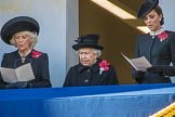 HRH The Duchess of Cornwall (Camilla), Her Majesty The Queen, and HRH The Duchess of Cambridge (Kate), singing, on the balcony of the Foreign and Commonwealth Office during the Remembrance Sunday Cenotaph Ceremony 2018 at Horse Guards Parade, Westminster, London, 11 November 2018, 11:18.