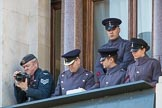 A team of army officers controlling the event's music (?), and an army photographer, on a top floor window of teh Foreign and Commonwealth Office during the Remembrance Sunday Cenotaph Ceremony 2018 at Horse Guards Parade, Westminster, London, 11 November 2018, 11:19.