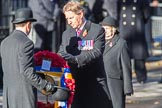??? hand the wreath on behalf of Royal British Legion to ???during Remembrance Sunday Cenotaph Ceremony 2018 at Horse Guards Parade, Westminster, London, 11 November 2018, 11:27. Text: THE LEGION OF THE LIVING SALUTES THE LEGION OF THE DEAD