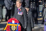 Air Marshal David Walker CB CBE AFC MA RAF (Retired), National President of the Royal British Legion, with the legion's wreath during the Remembrance Sunday Cenotaph Ceremony 2018 at Horse Guards Parade, Westminster, London, 11 November 2018, 11:27.