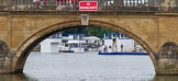 "Henley Royal Regatta 2013 (Wednesday): Seen through the main arch of Henley Bridge (with a big red ""No Rowing Craft"" sign( the blue and white boxes near the finish line of the Henley Royal Regatta 2013.. River Thames between Henley and Temple Island, Henley-on-Thames, Berkshire, United Kingdom, on 03 July 2013 at 09:16, image #6"