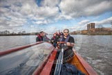 The Boat Race season 2012 - fixture CUBC vs Leander: The press launch, carrying photographers and television crews, returning to base after the CUBC vs Leander fixture. The Mile Post is on the left, and Surrey Bend in the background.. River Thames between Putney and Molesey, London, Greater London, United Kingdom, on 10 March 2012 at 14:31, image #153