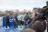 The Boat Race 2012: Setting the scene for the 2012 Boat Race:  The Cambridge Blue Boat squad arriving for the toss of the coin. In front of the Boat Race trophy umpire John Garret..     on 07 April 2012 at 12:29, image #48