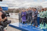 The Boat Race 2012: Setting the scene for the 2012 Boat Race:  The Oxford and Cambridge Blue Boat squads ready for the toss of the coin. In front of the Boat Race trophy umpire John Garret, on the left BBC presenter Clare Balding..     on 07 April 2012 at 12:31, image #50