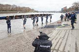 The Boat Race 2012: Getting Isis into the Thames for the Boat Race against Goldie, the Cambridge reserve boat: Stroke Tom Watson, Justin Webb, Geordie Macleod, Joseph Dawson, Ben Snodin, Julian Bubb-Humfryes, Chris Fairweather, bow Thomas Hilton, and on the right cox Katherine Apfelbaum..     on 07 April 2012 at 13:03, image #111