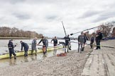 The Boat Race 2012: Getting Isis into the Thames for the Boat Race against Goldie, the Cambridge reserve boat: Cox Katherine Apfelbaum, stroke Tom Watson, Oxford boat house manager Pat Lockley, Justin Webb, Geordie Macleod, Joseph Dawson, Ben Snodin, Julian Bubb-Humfryes, Chris Fairweather, and Thomas Hilton..     on 07 April 2012 at 13:04, image #113